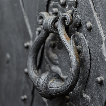 Metal knocker on the door style  photo