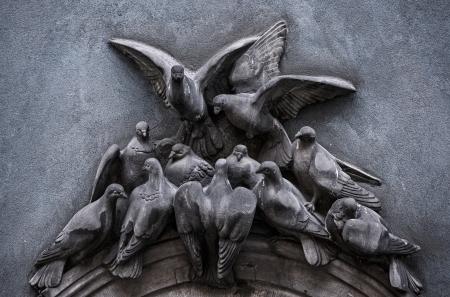 relievo: Sculpture pigeons  Stock Photo