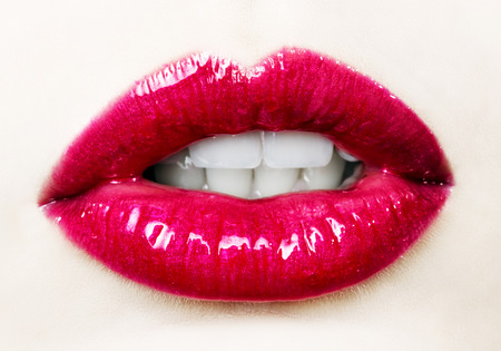 Beautiful female with red shiny lips close up photo