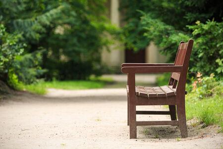 Wooden bench in the park in summer.Park Arkadia,Nieborow.  Stock Photo
