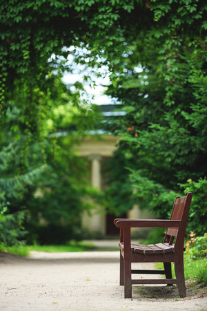 arkadia: Wooden bench in the park in summer.Park Arkadia,Nieborow.  Stock Photo