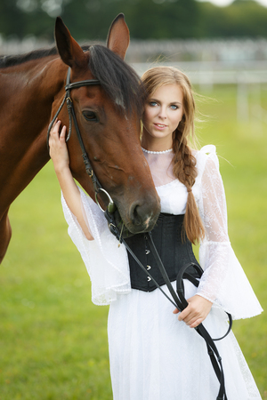vouge: Beautiful smiling woman with horse chestnut