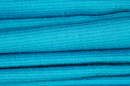 factitious: Synthetic fabric as background. Small depth of field