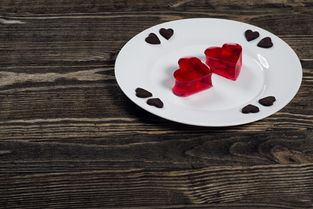 Heart of jelly and chocolate hearts photo