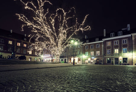 Christmas decorations on the old town of Warsaw at night photo