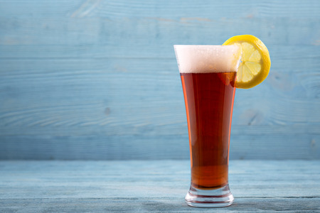 unwholesome: Glass of beer with lemon