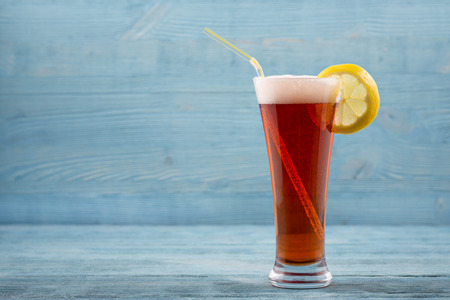 unwholesome: Glass of beer with lemon and sipper