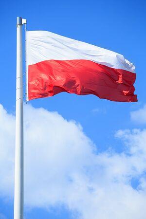 Polish flag on a background of blue sky