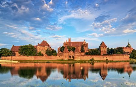 Teutonic Knights in Malbork castle in summer.