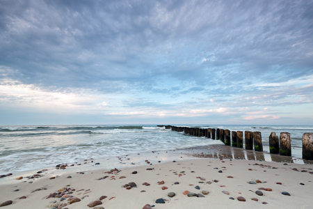 sea dock: Kuznica Beach on the Baltic Sea and beautiful sky with clouds Stock Photo