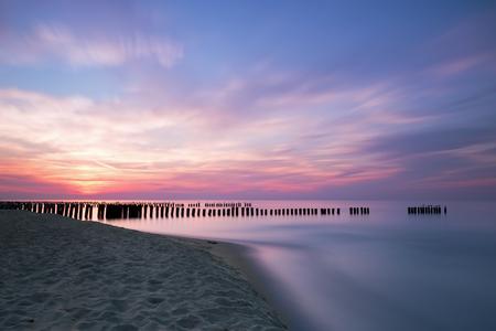 breakwaters: Sunset and breakwaters on the Baltic Sea.  Long exposure