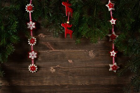 adorned: Old planks adorned with Christmas tree twigs and decorations