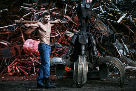 naked male body: Muscular man working on junkyard Stock Photo