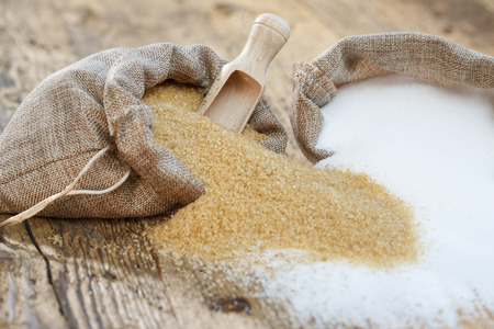 Various types of sugar, brown sugar and white. Small depth of field