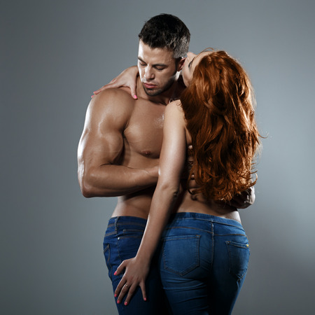 redhead: Passionate couple in studio Stock Photo