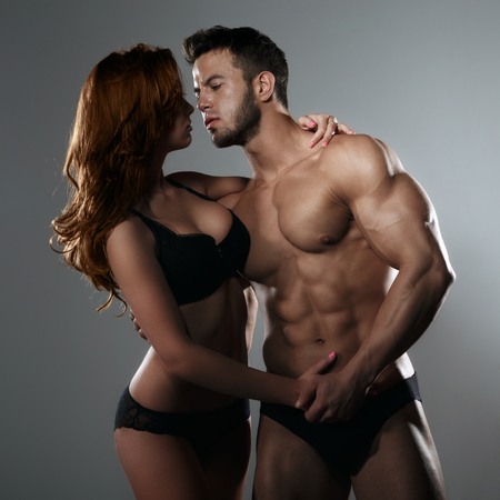 adult sexual: Passionate couple in studio Stock Photo