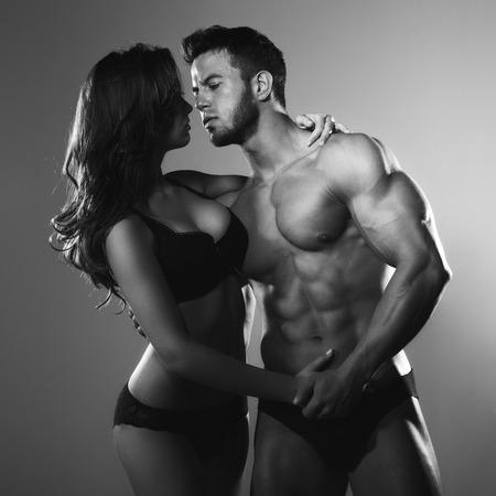 Passionate couple in studio Reklamní fotografie
