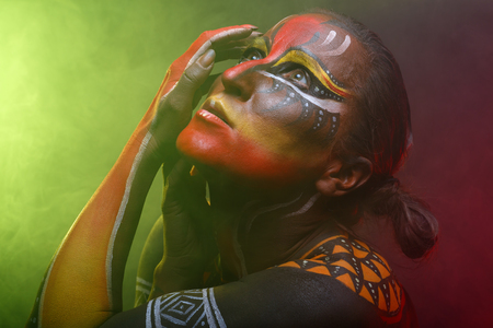 bodypaint: Bodypainting. Woman painted with ethnic patterns Stock Photo
