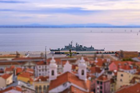 portugese: Warship in the port of Lisbon, tilt-shift effect. Stock Photo
