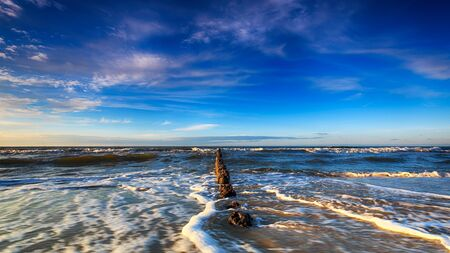 high dynamic range: Baltic Sea and the breakwater at dusk. HDR - high dynamic range Stock Photo