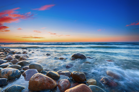 pebbles: Sunset over the Baltic sea. The pebbly beach in Rozewie. HDR - high dynamic range