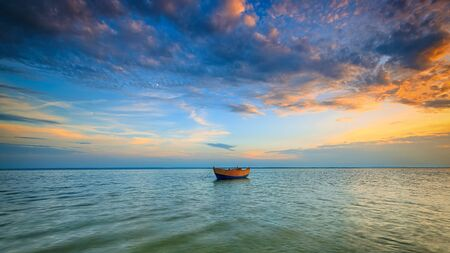 high dynamic range: Lonely boat on the Baltic Sea at sunset. HDR - high dynamic range