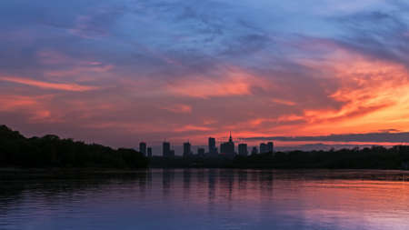 horizon reflection: Silhouette of the city of Warsaw during sunset