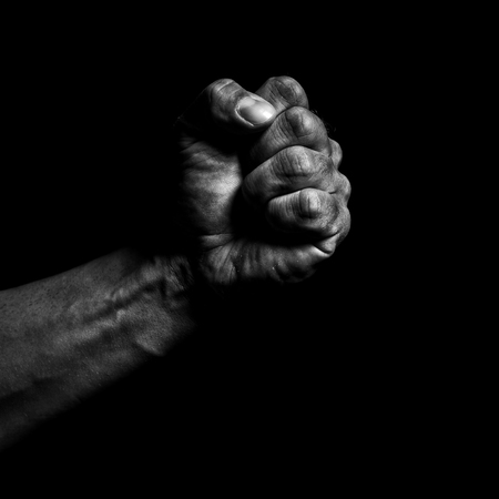 Clenched fist on a black background