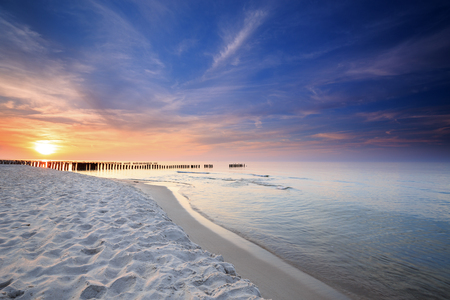 groynes: Sunset on the beach on the Baltic Sea