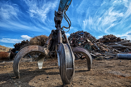 Gripper excavator on a scrap yard. HDR - high dynamic range Foto de archivo