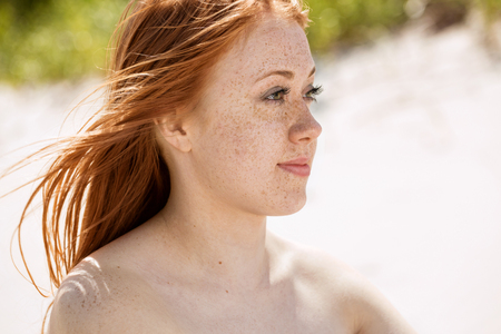 Portrait of a freckled redhead girl