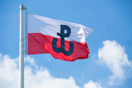Polish flag with the symbol of Polish Fighting. Symbol of the Warsaw Uprising in 1944 Reklamní fotografie