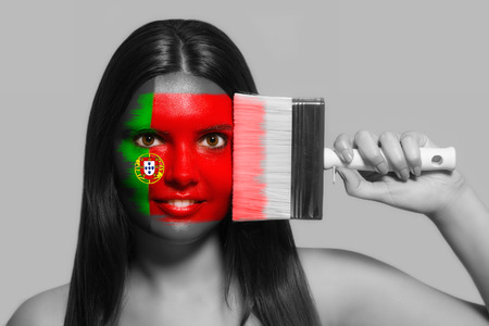 Female supporter in national colors of Portugal