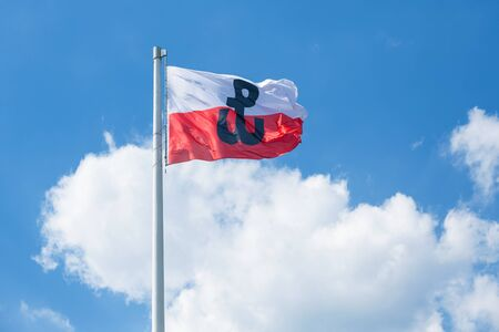Polish flag with the symbol of Polish Fighting. Symbol of the Warsaw Uprising in 1944 Stock Photo