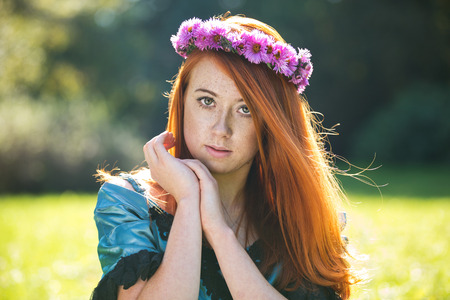 Portrait of a beautiful redheaded freckled woman with a wreath Stock Photo