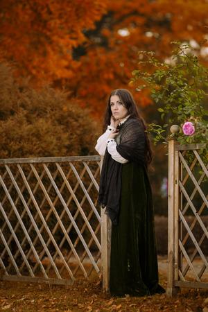 Woman in Victorian dress in autumn scenery Reklamní fotografie