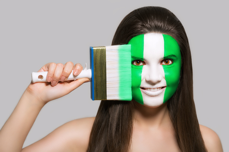 Female supporter in national colors of Nigeria Stock Photo