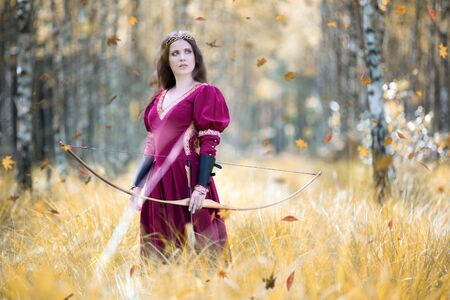 An elf archer with a bow in the woods Reklamní fotografie