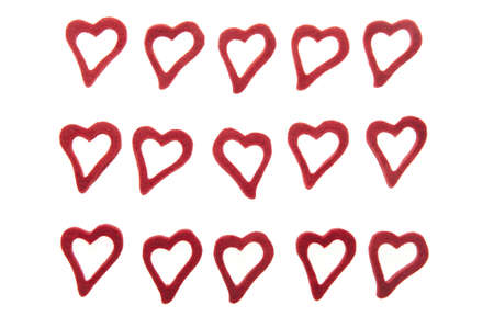 trifles: 15 ornamental hearts on white background made from felt. Stock Photo