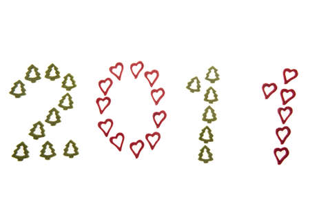 Year 2011 made from ornamental hearts and fir-trees.