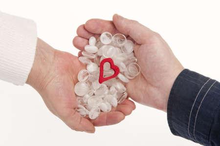 Pellucid stones and heart in hands - tender relationships. photo