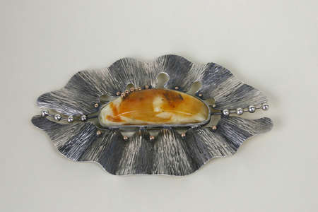 broach: Brooch, made from gold, silver and amber on the light background. Stock Photo