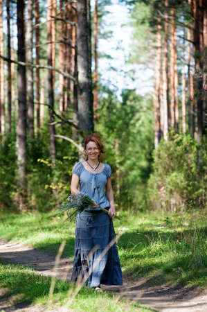 Red-haired women walking on path in the wood Stock Photo - 5942686