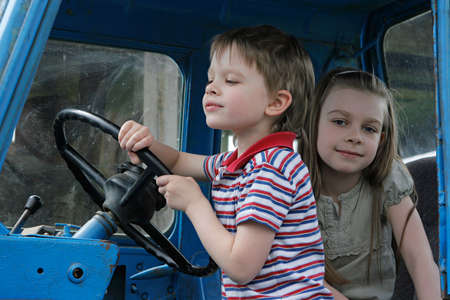 Brother and sister first time in tractor cab. photo