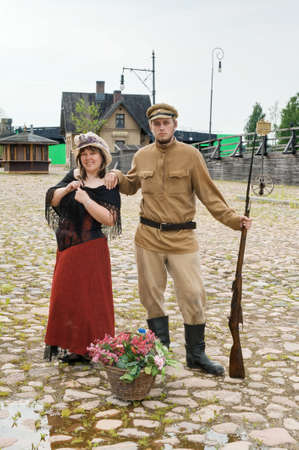Couple of lady and soldier shown on retro-style picture. Costumes accord the times of World War I. Photo made at cinema city Cinevilla in Latvia. Stock Photo - 8643272