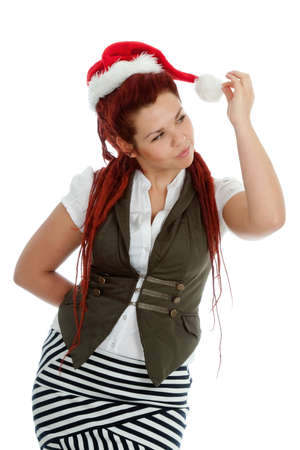 Young modern girl wearing Santa Claus hat isolated on white background. Stock Photo - 11432263