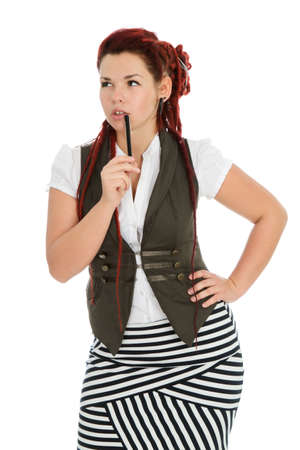 Beautiful accountant with pen wearing vest and striped skirt isolated on white background  photo