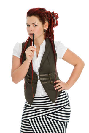 Beautiful young accountant with pen wearing vest and striped skirt isolated on white background  photo