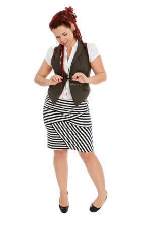 Modern beautiful girl with pen in striped skirt isolated on white background  photo