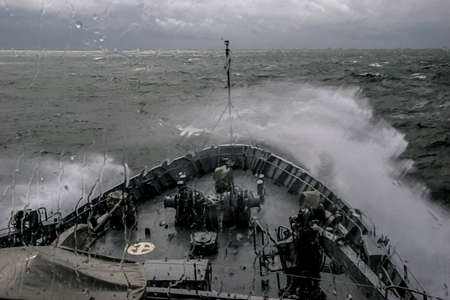 Ship in sea storm. Storm at Baltic sea. Warship training in the Baltic Sea during a storm. NATO military ship in Baltic sea, Latvia. NATO military ship at sea during a storm. view from ships the bow. Foto de archivo - 114961227